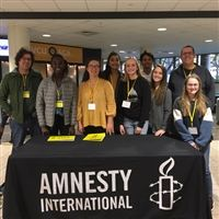 Amnesty International club at a conference.