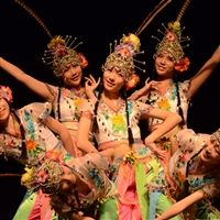 Renmin school performers in costume on stage.