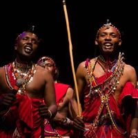Maasai tribesmen dancing on stage at Severn School.
