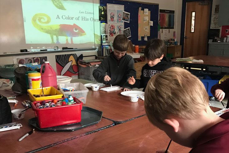 Severn students work on an Open Doors extension activity after school.