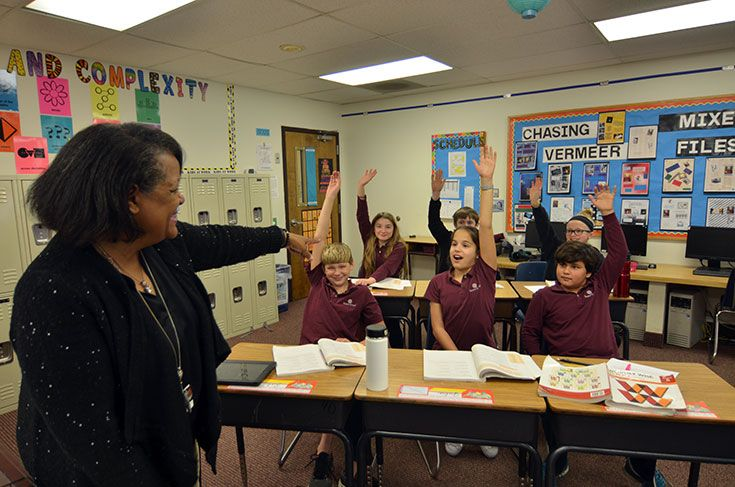 Severn fifth graders raising their hands, eager to share their ideas during Open Doors