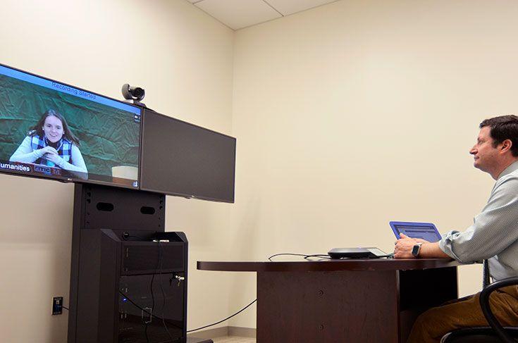 Severn Finanacial Algebra teachers talks to a MSON student through video seminar technology.