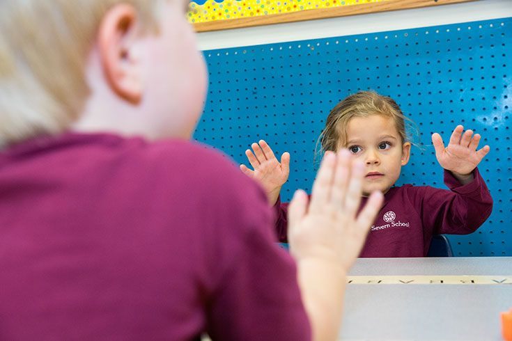 Children in the early childhood classroom learning patterns by clapping.