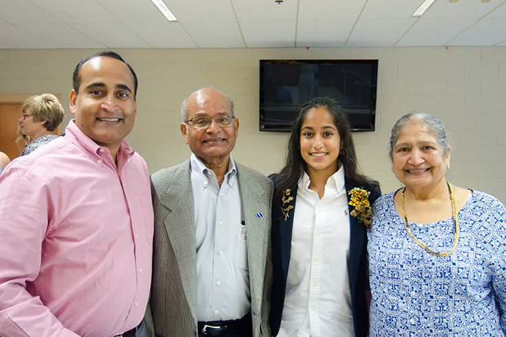 Severn high school student Shreeyah Bahethi stands with her grandparents at the National Honor Society induction ceremony.
