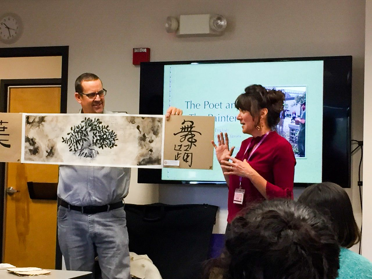 "Severn School teachers present at a conference holding artwork."" width="