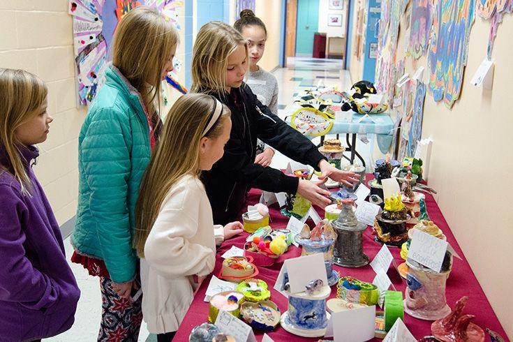 """Severn School students look at artwork on display."""" width="""