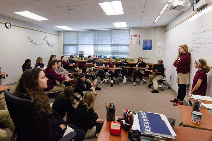 Severn School students lead their peers in a group discussion.