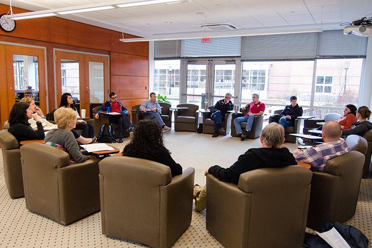 Severn School teachers meet in small groups.