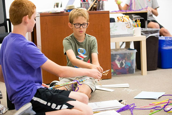 Severn School middle school students build a robot arm with every day materials.