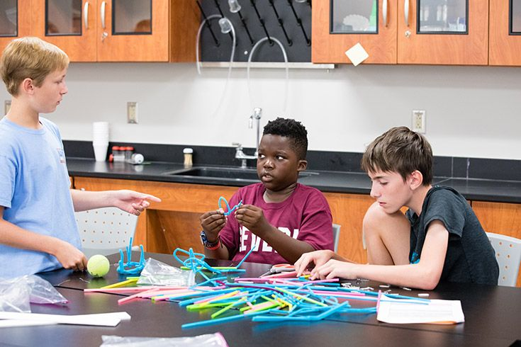Severn School middle school students working on a building challenge.