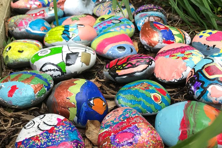 Student created rocks with fish painted on them.