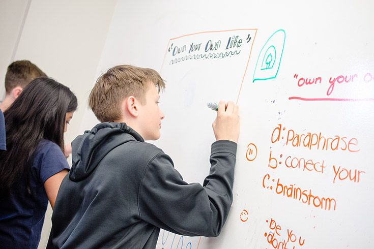 Severn School middle school students work at the board.