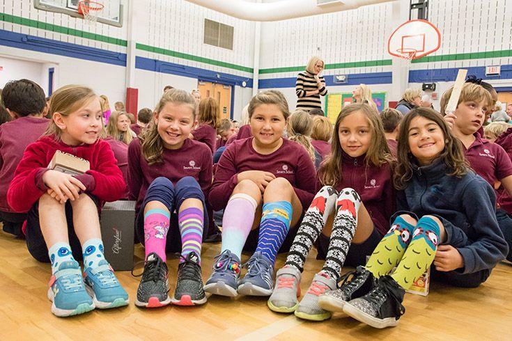 Severn School elementary school students show off their crazy socks