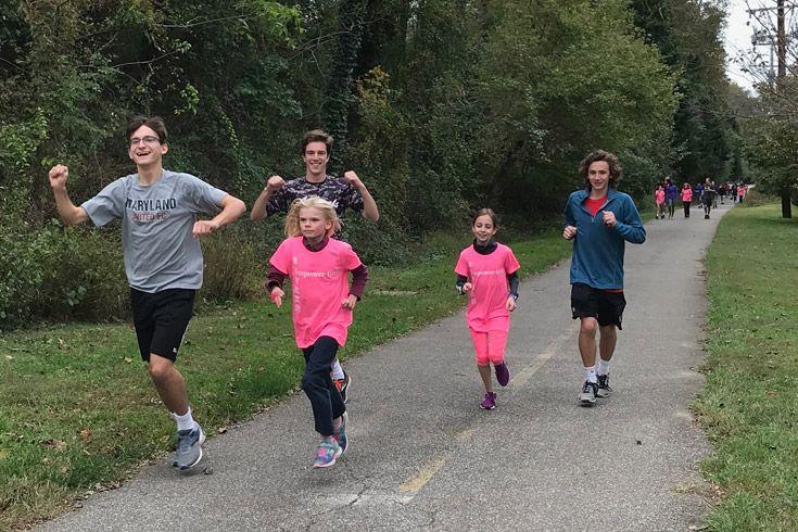 Severn school students run on the trail.