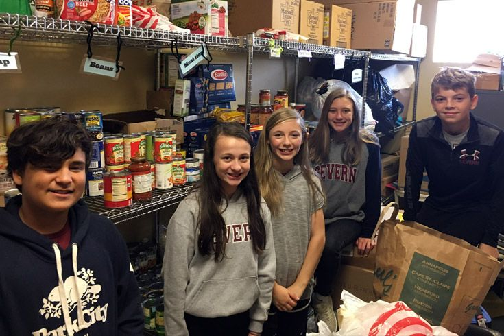 Severn School students volunteer at a community center.