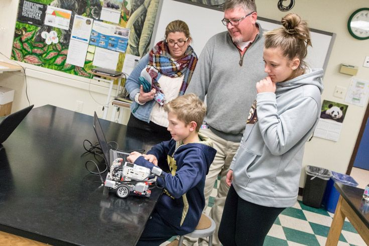 "Severn students demonstrates robotics programming to his family."" width="