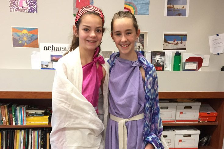 Severn School middle school students dress in togas for the Saturnalia celebration