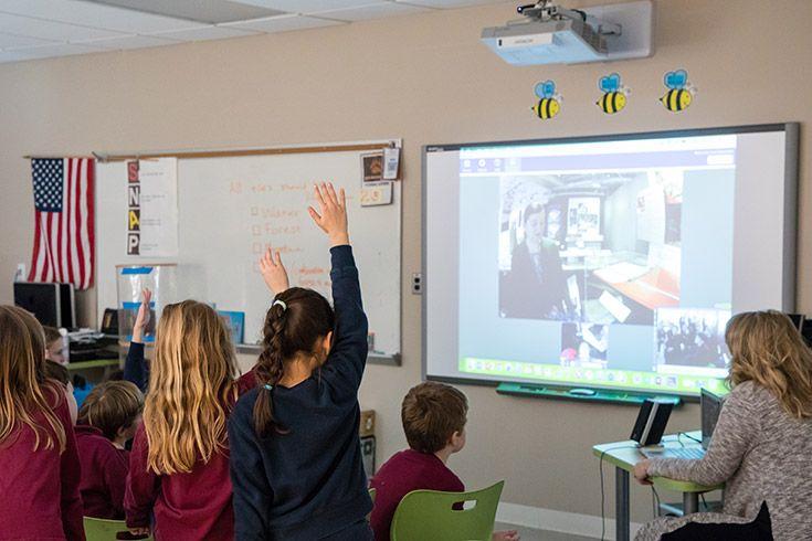 Severn School students watch a video on a Smart Board