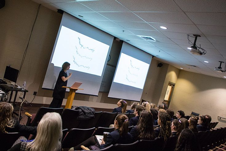 Severn School alumni teaches a class to high school students.
