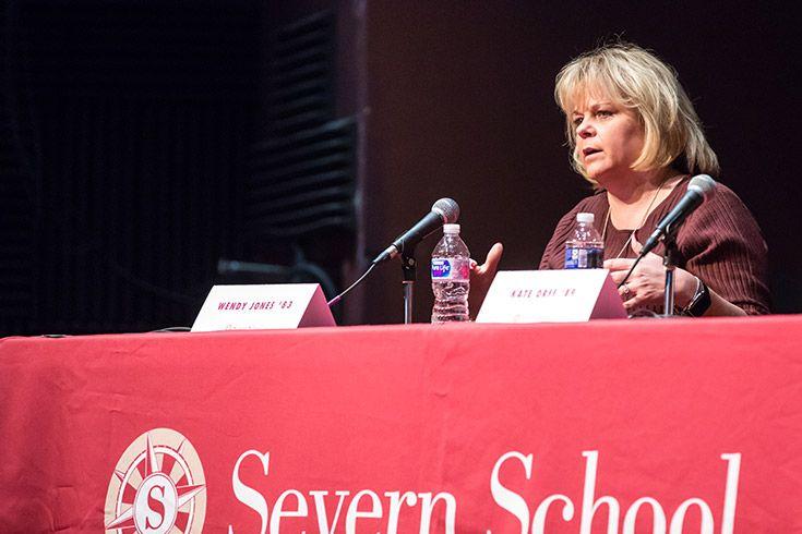 Panelist speaking on stage at Severn School