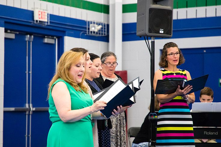Severn School teachers sing at the 5th grade promotion ceremony