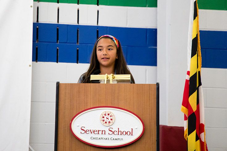 Severn School elementary school student speaks at a podium.