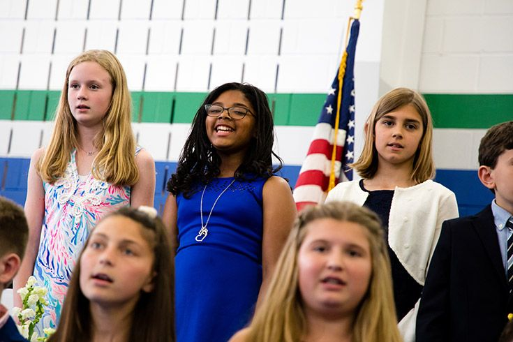 Severn School elementary school students sing at an assembly.