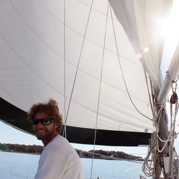 Severn School alumnus on a boat in Colombia.