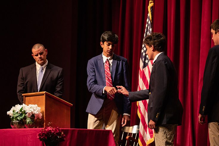 Severn School high school students sign the honor code book.