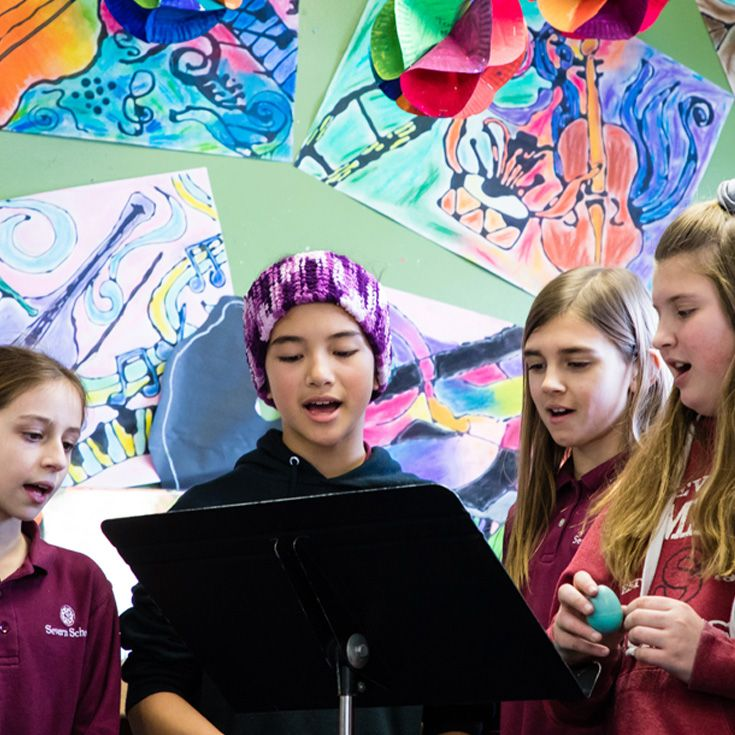 Severn School elementary school students singing in the library.