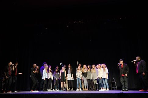 Upper School Vocal Ensemble takes the stage with Ball in the House at the Friday evening performance.