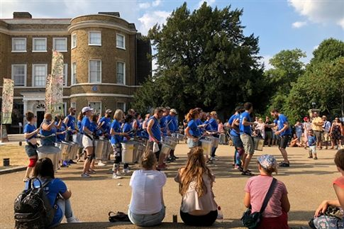 Mr. Donn attended an outdoor Drum Works performance in London.
