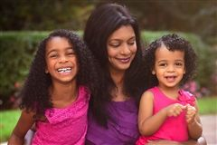 Sharita with her daughters Leela, 6 and Ella, 2
