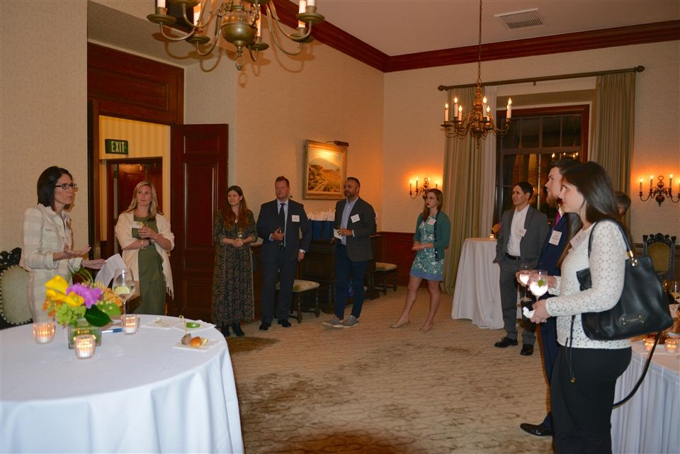 Ward delivering remarks to attendees, with Brooke Booth P '24, '26, Jocelyn Fritz Hayes '90, Sam Hulefeld '90, Evan Hayes, Caitlin Kluchnik '11, Brandon Stroman '94, Andrew McReynolds '98, Mallory Jaffe '02