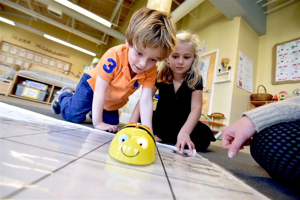Pre-K students programmed BeeBots during the Hour of Code.