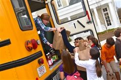 Mullery Doar helped fill one of Shore's buses with meal bags