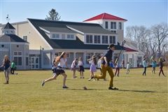 On warm spring days, lacrosse sticks appear at Upper School recess.