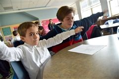 Eighth graders taught Spanish to Pre-K students.