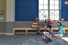 Sixth graders practiced the guitar