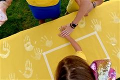 Students added handprints to House banners