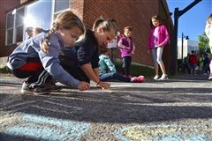 Students chalked words of encouragement for Shore sports teams