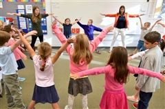 Laurel Fitzpatrick led a yoga sequence in her first grade classroom.