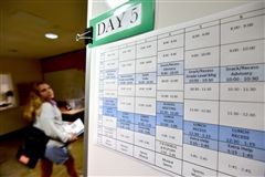 Upper School students can consult a copy of each day's schedule in the Walsh Building lobby.