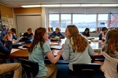 Eighth graders discussed their reading around the Harkness table