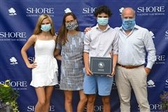 The Falk family marked the unique occasion by wearing face coverings.