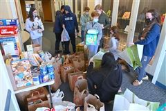 Eighth and ninth graders bagged 684 pounds of donated items.
