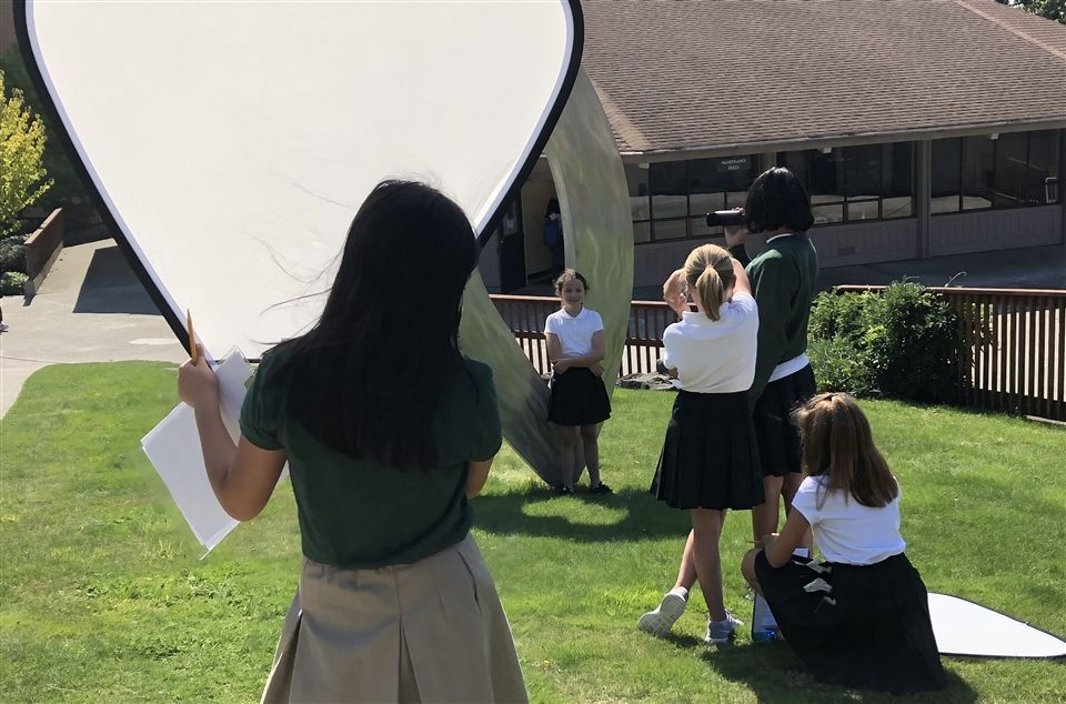 Girls filming during a social studies class project.