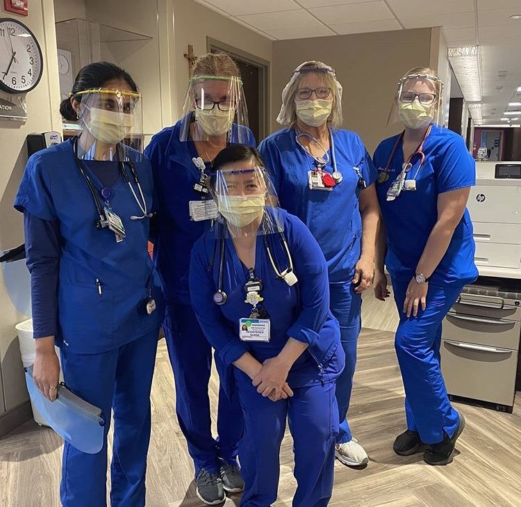 Health care workers wearing the masks Margaret created
