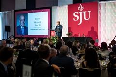 Mr. Mike Hare '79 receiving the Hogan Award (photo courtesy of St. Joe's University)