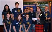 The ECHS Interact Club presenting the fundraising checks to Rick Rizzs for Toys for Kids and to the Rotary Club for fundraising efforts.  (Back row L-R): Surabhi Sonali, Incoming Vice President; Brad Barrett, Treasurer; Jerome Siangco, President; Rick Rizzs, Seattle Mariners broadcaster; Cary Young, Rotary President; Bob Sprung, ECHS Interact Advisor (Front row L-R): Hannah Kennedy, incoming Director of Communications; Claire Garrett, Incoming President; McKenna Boit, Vice President